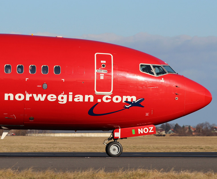 The iconic red nose of a Norwegian Air airplane