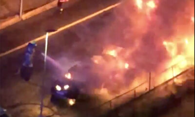 Emergency services tackling a car fire in Oslo, Norway