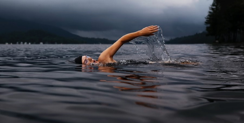 A swimmer in a Norwegian fjord