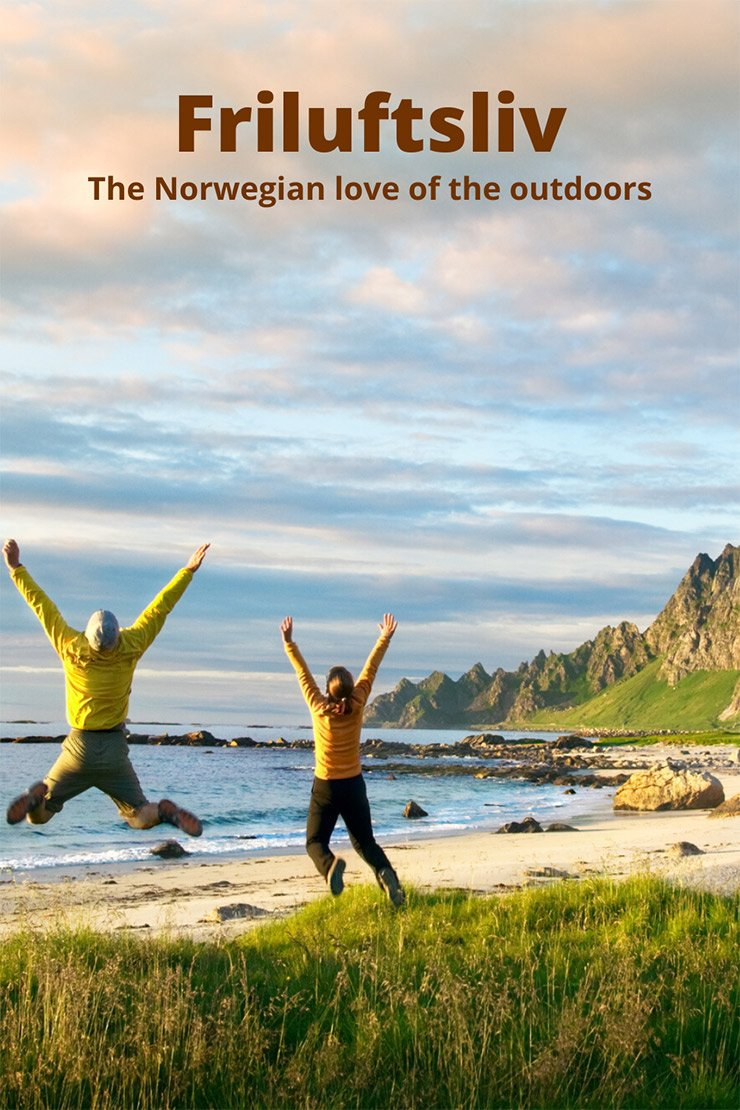 A couple jumping with happiness in the Norwegian outdoors