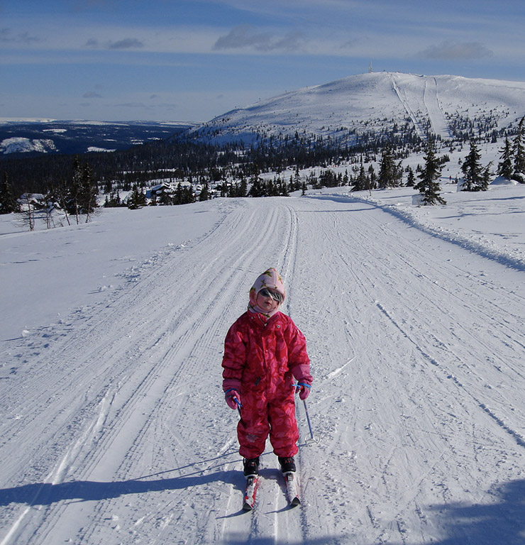 A young child cross-country skiing in Norway