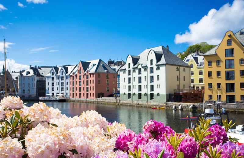 Buildings and flowers in Ålesund, Norway, in the summer