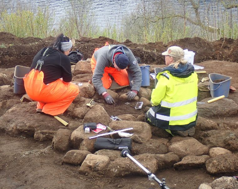 Norwegian archaeologists working on the excavation of the burial cairn in Norway