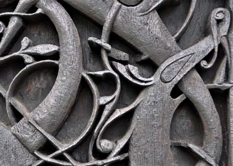 Detail of Viking-inspired carvings on Urnes Stave Church in Sogn og Fjordane