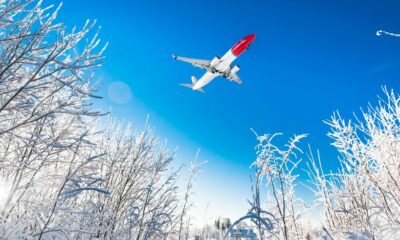Norwegian 737-800 airline in the sky on a snowy day