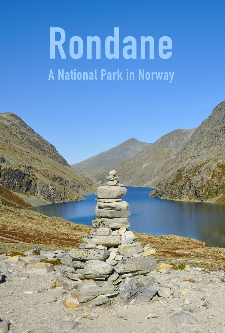 Cairn in front of a lake in Rondane National Park in central Norway