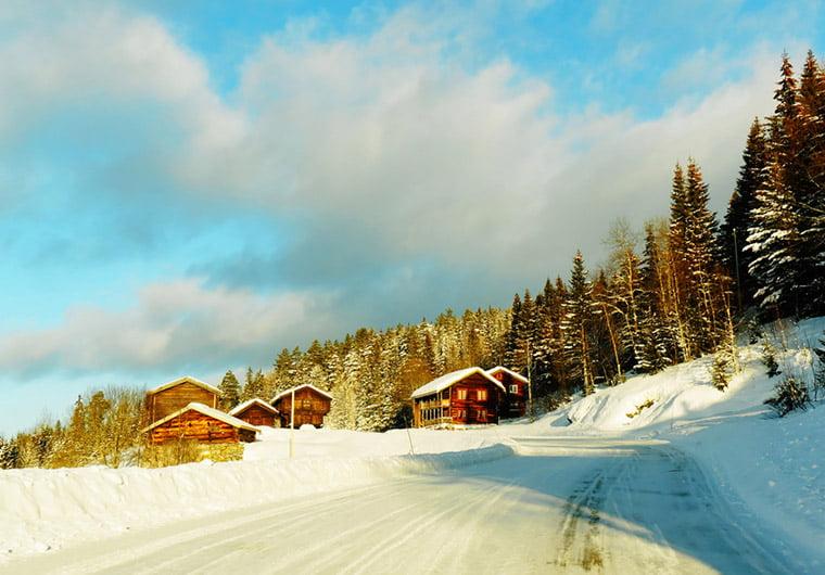 Snowy mountain farm scene in Norway