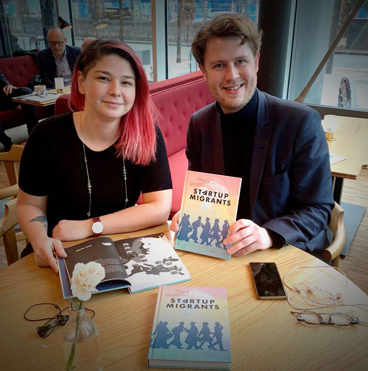 Startup Migrants books in a cafe