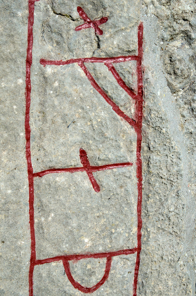 A close-up of Viking runes on a Scandinavian runestone