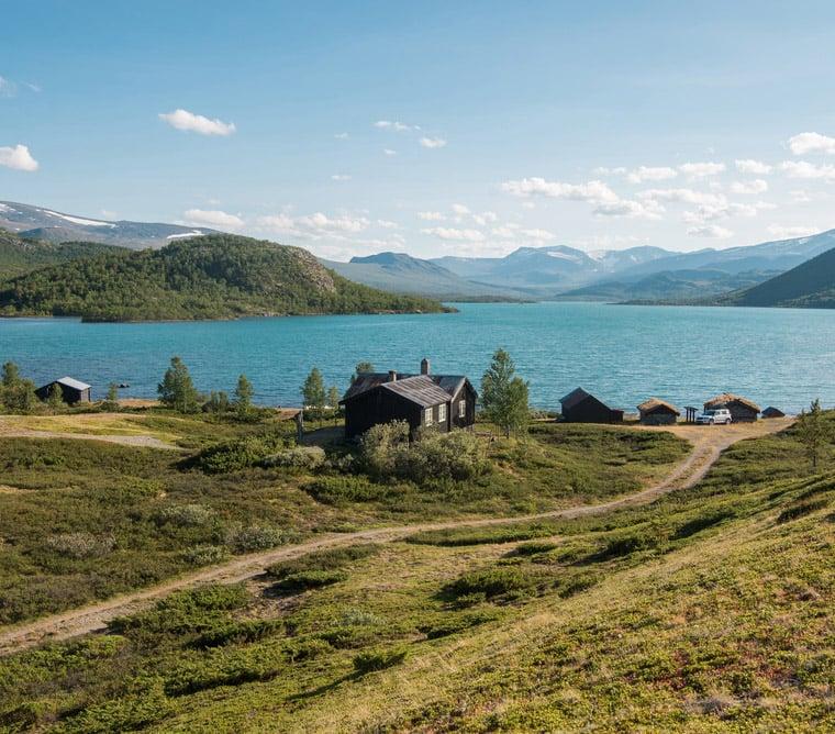 Wooden cabin by Gjende lake in Norway