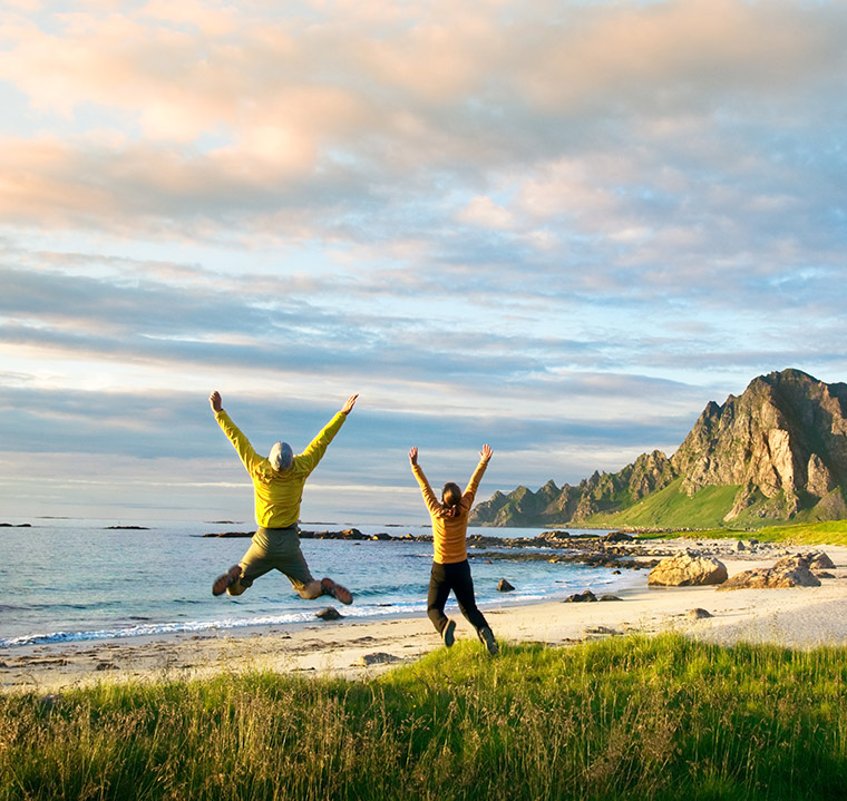 Happy couple on a beach in northern Norway