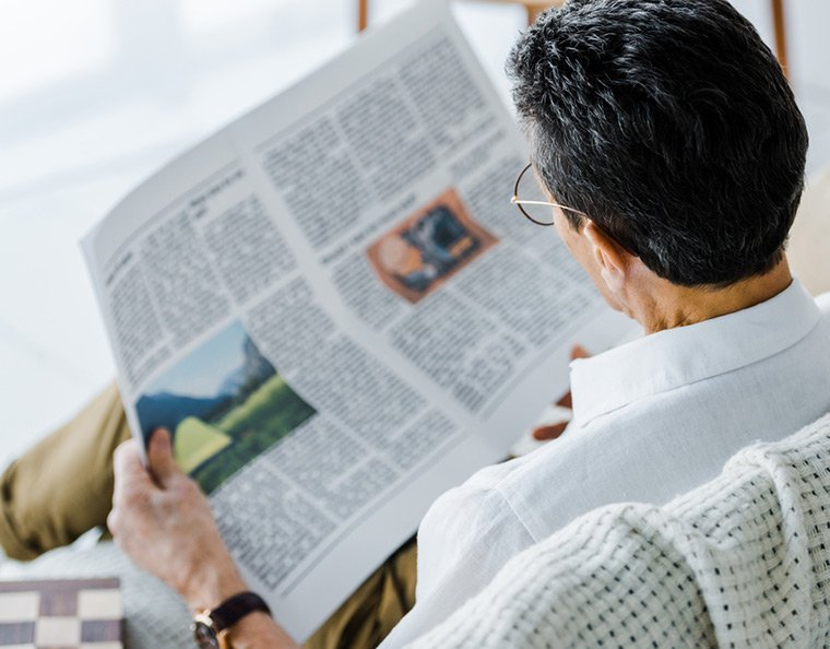 Man reading a newspaper in Norway