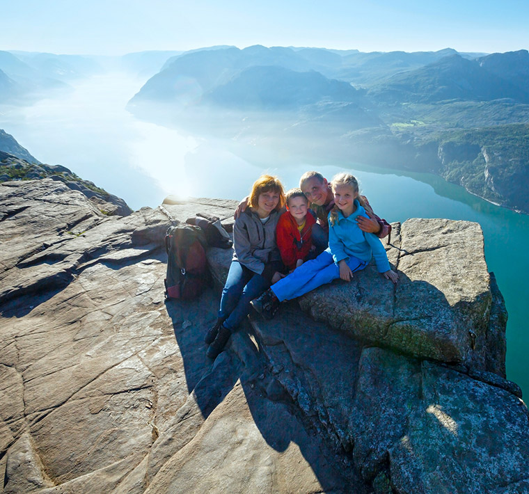 Norwegian family hiking at Preikestolen
