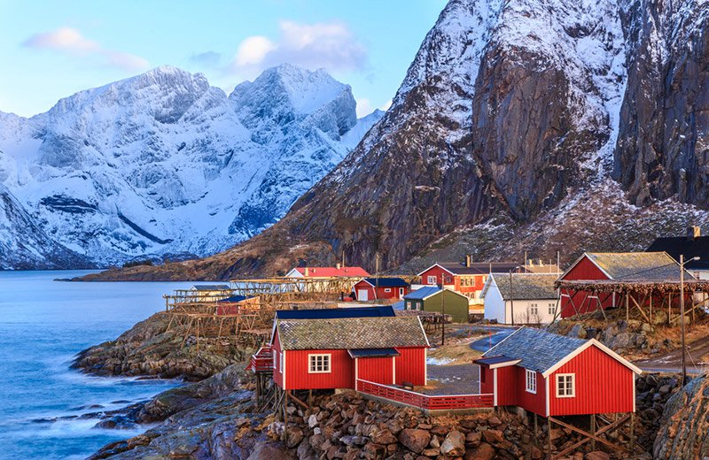 Red fishing cottages in Reine, a Norway vacation hotspot