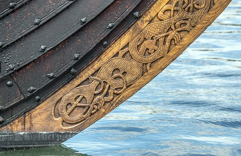 Close-up of carvings on a Viking ship