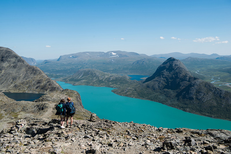A couple hiking the Besseggen ridge in central Norway