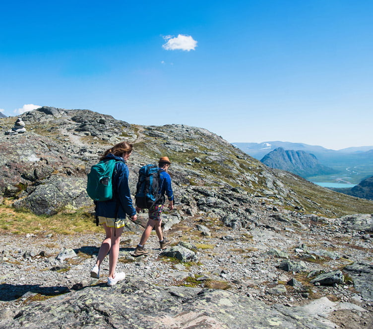Norwegian hikers on the Besseggen ridge in Jotunheimen National Park, Norway