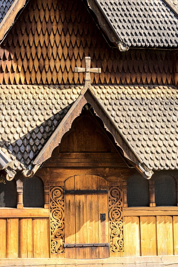 A close-up of the exterior of Heddal wooden church in rural Norway