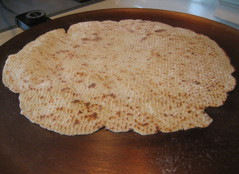 Typical homemade Norwegian lefse on a traditional griddle in Norway
