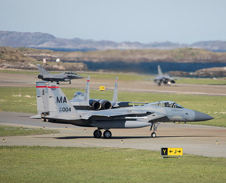 Two american F-15 getting ready for take off with two french rafale in the background during the exercise Arctic Challenge Exercise 2019 at Bodø Air Station.