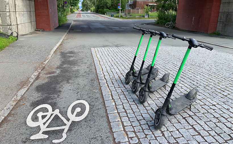 Electric rental scooters outside Lerkendal Stadium in Trondheim, Norway