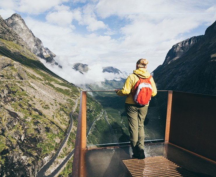 Scandinavian woman standing at one of the Trollstigen road viewpoints