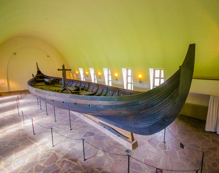 The restored Gokstad ship on display at the Oslo museum