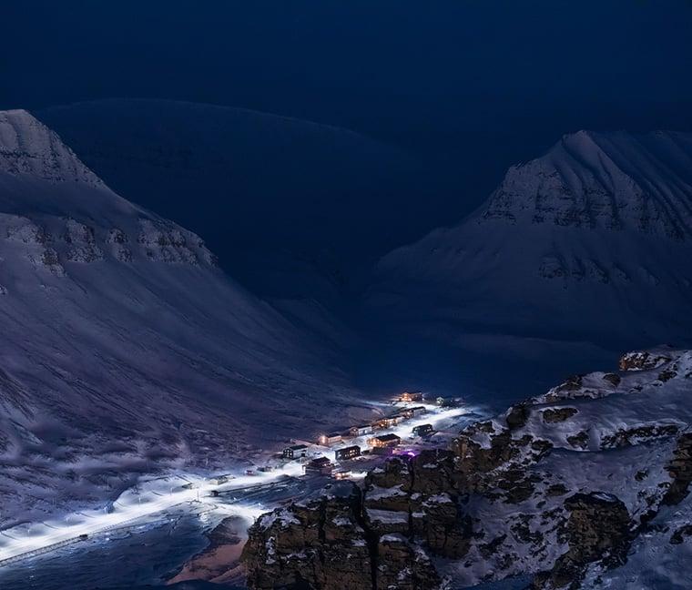 Nybyen on the outskirts of Longyearbyen, Svalbard, in blue light