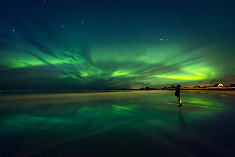 Northern lights reflections in the water