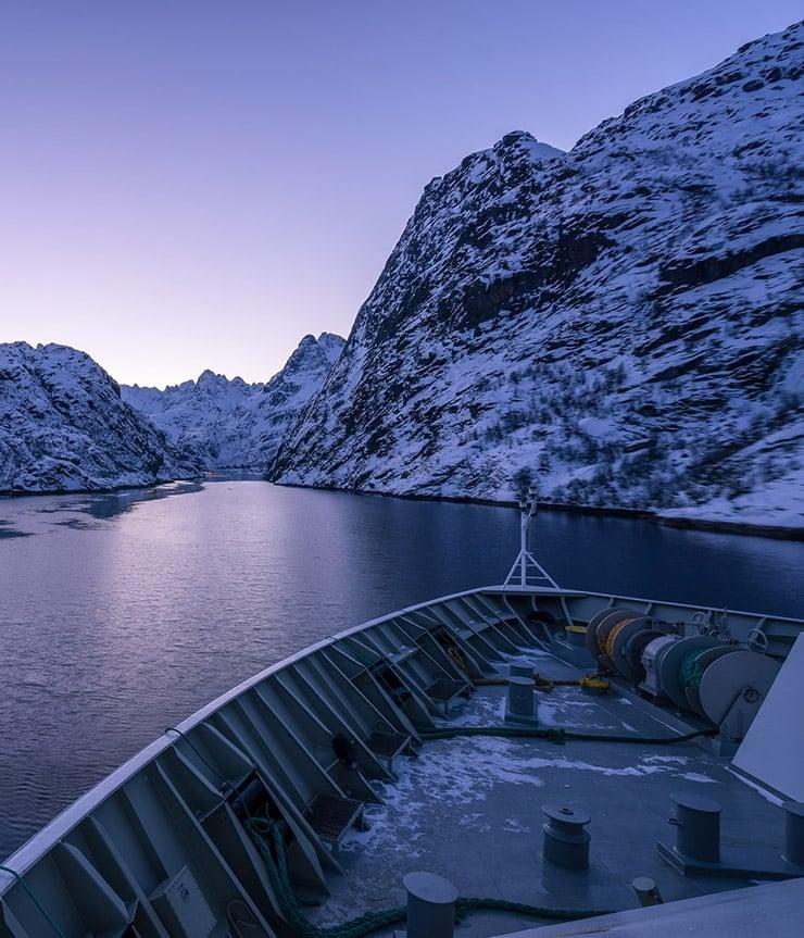 Entrance to Norway's Trollfjord in purple light