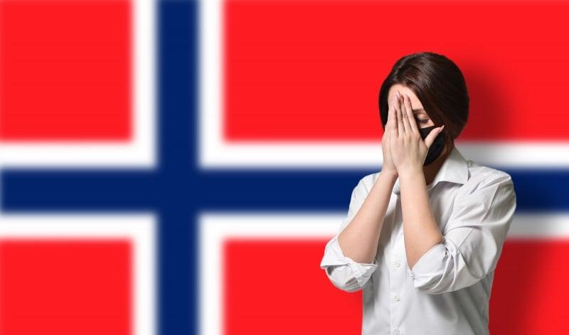 Coronavirus patient in front of the flag of Norway