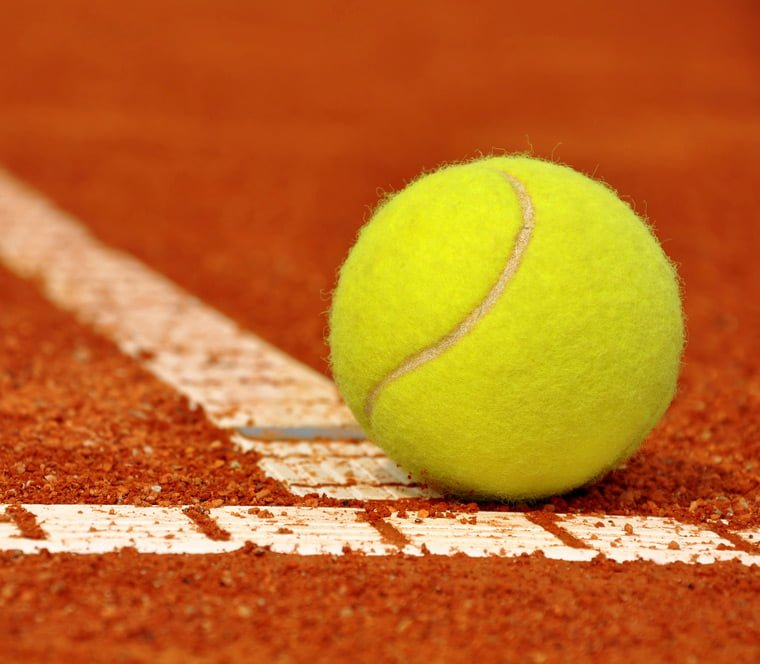 Tennis ball on a clay court