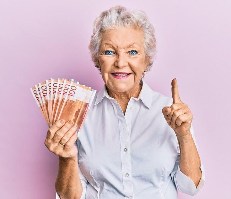 elderly norwegian holding money