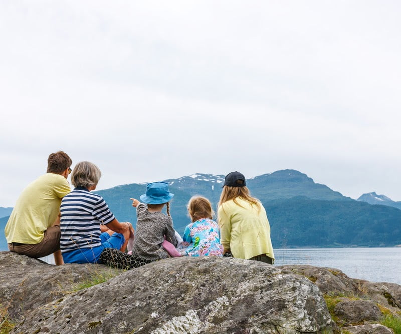 norway family watching fjord