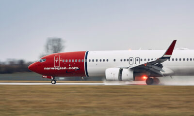 Norwegian Air plane taking off in the rain