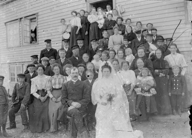 A historic wedding party outside a house in Fjord Norway