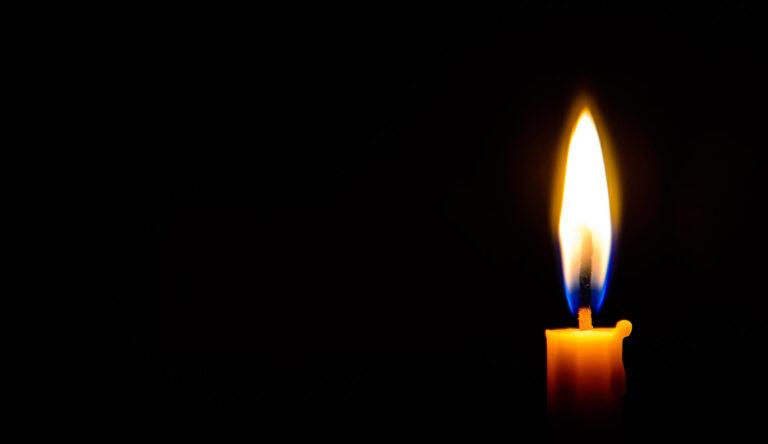 Memorial candle burning in Arctic Norway