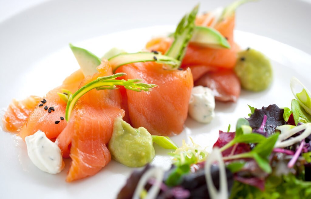 Norwegian salmon on a plate with garnish