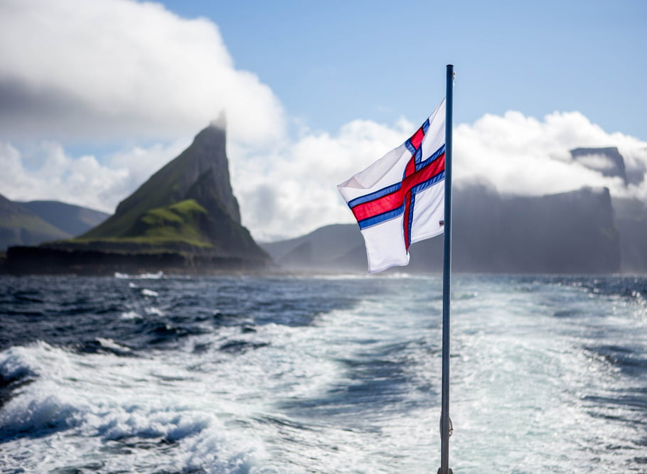 The landscape and flag of the Faroe Islands