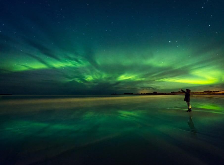 Northern lights photographer in Scandinavia.