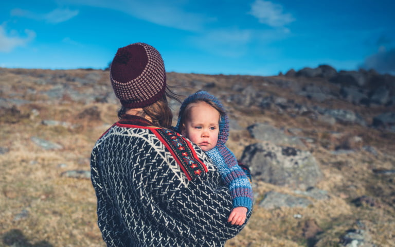 Norwegian baby and parent out in the nature of Norway.