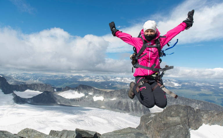 A happy hiker on the Norwegian mountains.