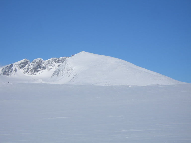 The mountain peaks of snow-covered Snøhetta in central Norway.