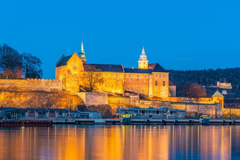 A floodlit view of Oslo's Akershus Castle in Norway