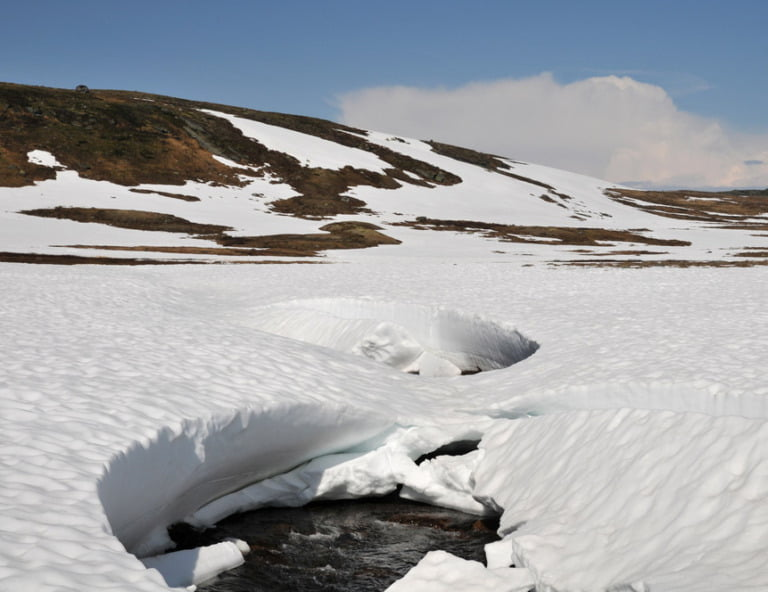 Snowmelt on the Hardangervidda mountain plateau in Norway
