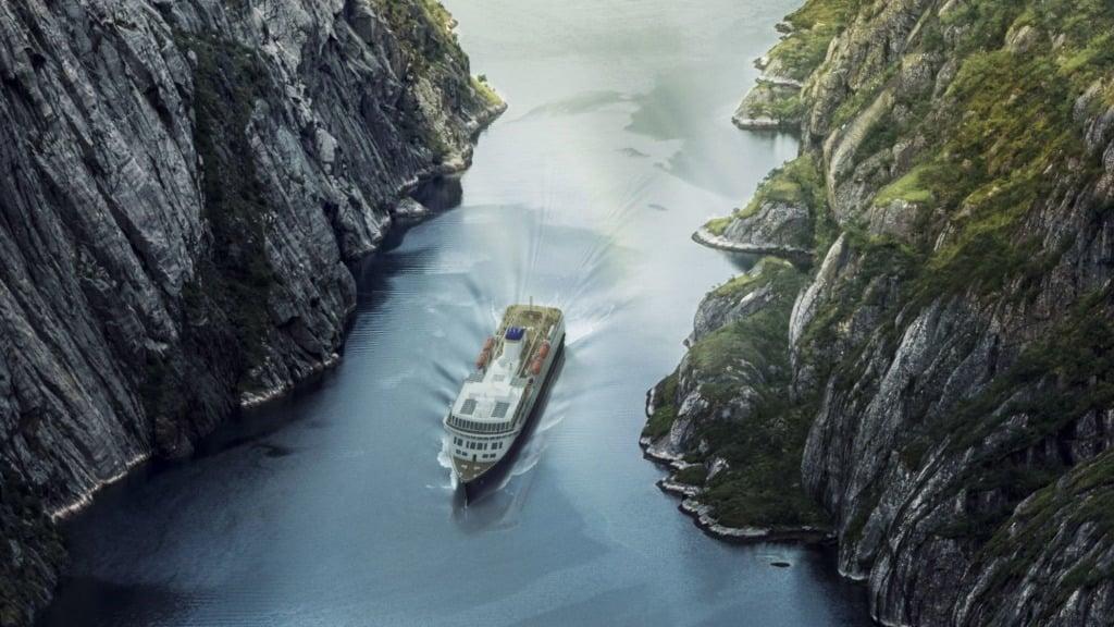 Havila Kystruten vessel in a Norwegian fjord