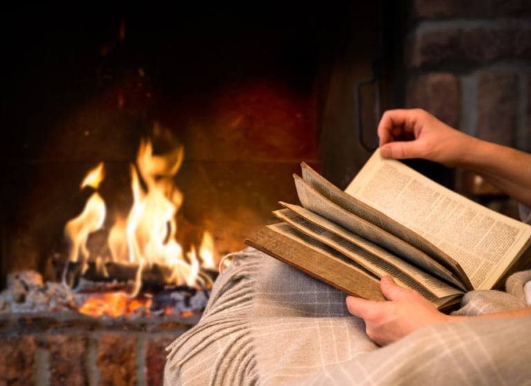 Reading a Norwegian crime novel by a cosy fireplace