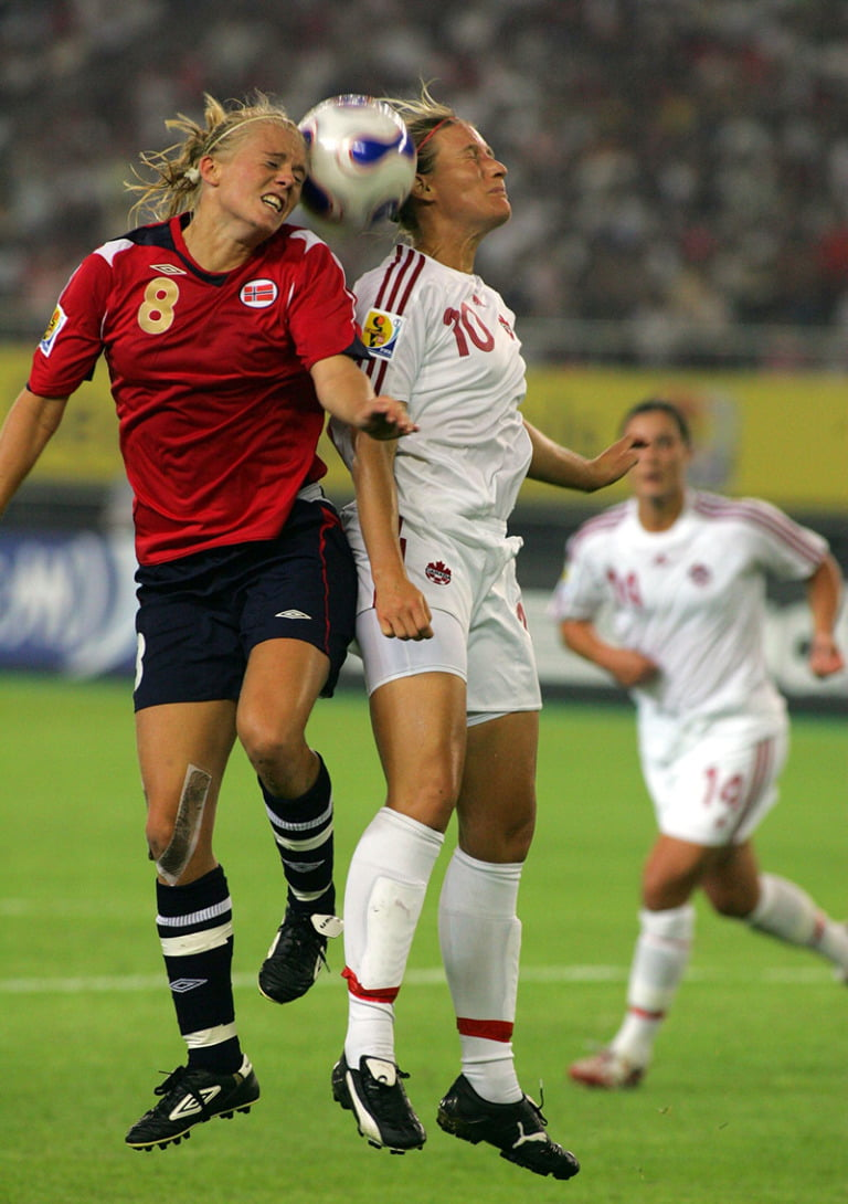 Solveig Gulbrandsen of Norway, left, competes with Martina Franko of Canada during a Group C match of the 2007 FIFA Womens World Cup in Hangzhou, east Chinas Zhejiang province 12 September 2007. Norway defeated Canada 2-1.