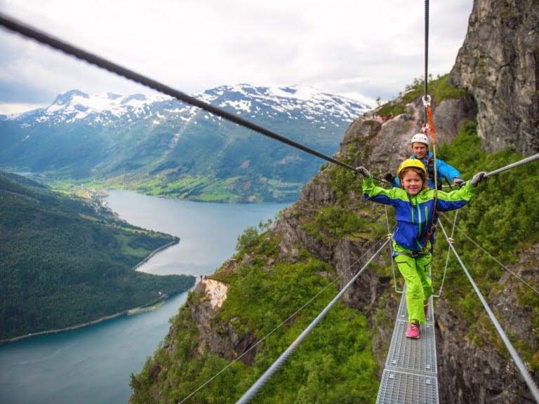 A family enjoying the spectacular mountains around Loen, Norway