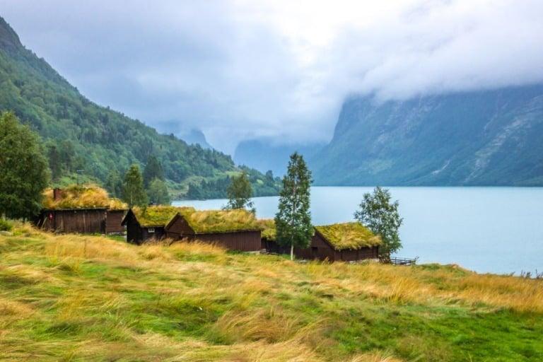 Historic farm buildings by the lakeside in Loen, Norway